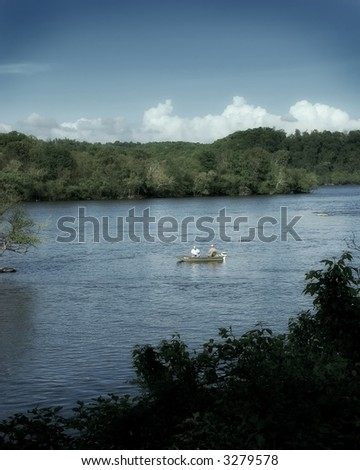 Muted color photo of two men fishing on the Susquehanna River, Maryland - stock photo