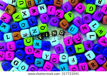 muticolor mixed  letters and black word find - stock photo