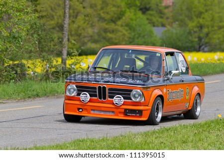 MUTSCHELLEN, SWITZERLAND-APRIL 29: Vintage race touring car BMW 2002 Tii from 1974 at Grand Prix in Mutschellen, SUI on April 29, 2012.  Invited were vintage sports cars and motorbikes. - stock photo