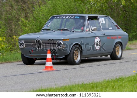 MUTSCHELLEN, SWITZERLAND-APRIL 29: Vintage race touring car BMW 2002 touring from 1972 at Grand Prix in Mutschellen, SUI on April 29, 2012.  Invited were vintage sports cars and motorbikes. - stock photo