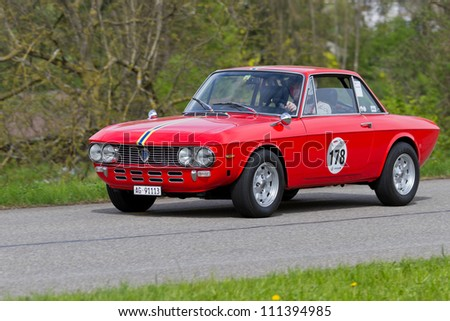 MUTSCHELLEN, SWITZERLAND-APRIL 29: Vintage race touring car Lancia Fulvia 1.3S from 1972 at Grand Prix in Mutschellen, SUI on April 29, 2012.  Invited were vintage sports cars and motorbikes.