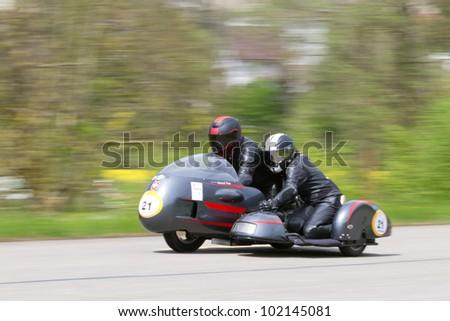MUTSCHELLEN, SWITZERLAND-APRIL 29: Vintage sidecar motorbike BMW Kneeler  from 1968 at Grand Prix in Mutschellen, SUI on April 29, 2012.  Invited were vintage sports cars and motorbikes. - stock photo