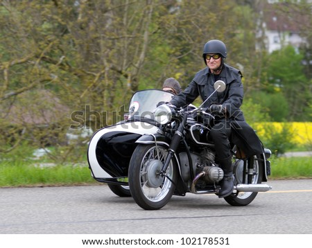 MUTSCHELLEN, SWITZERLAND-APRIL 29: Vintage sidecar motorbike BMW R 51 3 from 1954 at Grand Prix in Mutschellen, SUI on April 29, 2012.  Invited were vintage sports cars and motorbikes. - stock photo