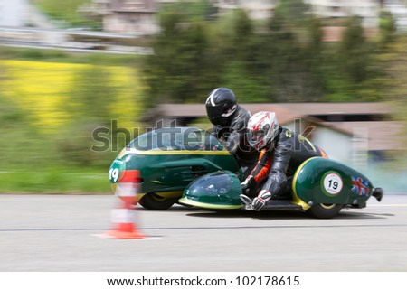MUTSCHELLEN, SWITZERLAND-APRIL 29: Vintage sidecar motorbike Triumph  from 1964 on display at Grand Prix in Mutschellen, SUI on April 29, 2012.  Invited were vintage sports cars and motorbikes. - stock photo