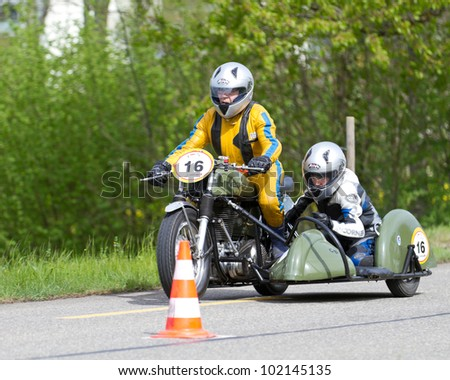 MUTSCHELLEN, SWITZERLAND-APRIL 29: Vintage sidecar motorbike Velox BSA WM 20 from 1952 at Grand Prix in Mutschellen, SUI on April 29, 2012.  Invited were vintage sports cars and motorbikes. - stock photo