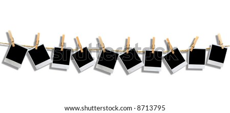 Muttiple Blank instant photo Frames Hanging by Clothespins on a Rope With Drop Shadow - stock photo