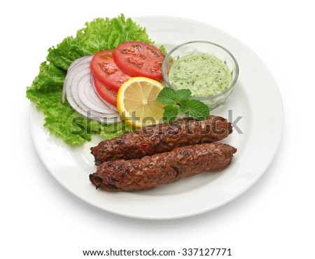 mutton seekh kabab with mint chutney isolated on white background - stock photo