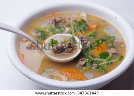 Mutton soup isolated on white background - stock photo