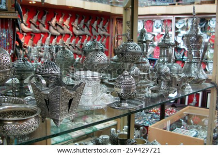 MUTTRAH, OMAN - DEC 22 2007:Silver Merchandise on display at Muttrah Souq in Oman.Al Dhalam, Muttrah Souq is one of the oldest marketplaces in the Arab world. - stock photo