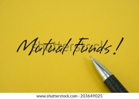 Mutual Funds! note with pen on yellow background - stock photo