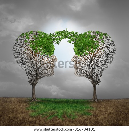 Mutual support and saving one another as a benefit to each other business concept as two sick trees with new leaves growth emerging shaped as a human head providing a revival for success. - stock photo