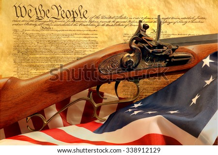 muzzleloader rifle with constitution and flag - stock photo