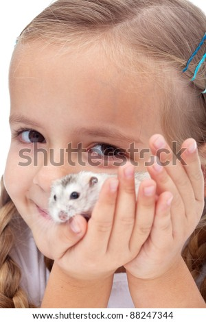 My best present ever - little girl happy for getting a hamster, closeup