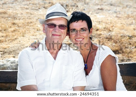 my dad and I - bright family lifestyle portrait of daughter and father sitting close together - stock photo