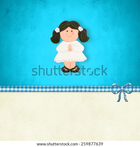 My First Holy Communion invitation card, happy brown girl praying  on blue background with blank space for customization - stock photo
