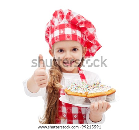 My first muffins are ready - little girl with chef hat and cookies, isolated - stock photo