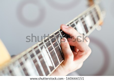 my friend is playing guitar