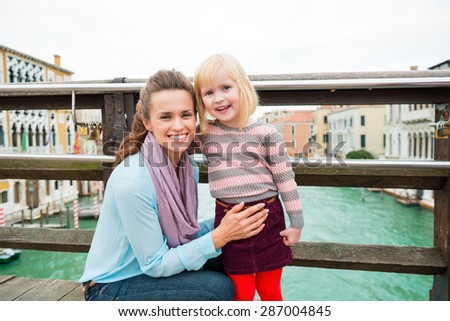 My girl is getting so big! She's the perfect little tourist, eager to go out and discover the magic of Venice with us parents. - stock photo