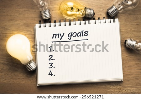 My Goals as memo on notebook with many light bulbs - stock photo
