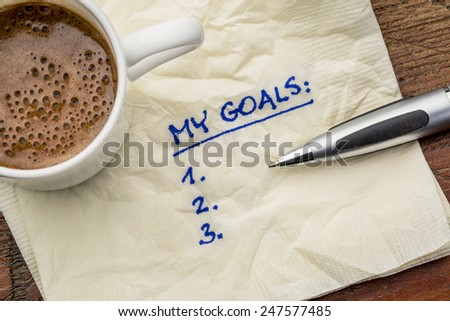 my goals list on a napkin with cup of coffee - stock photo