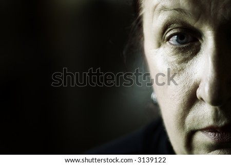 my mother (special photo film toned f/x, focus on her eye) - stock photo