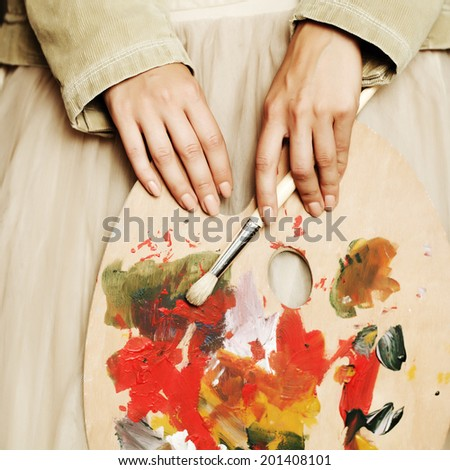 My muse, art palette in female hand - stock photo