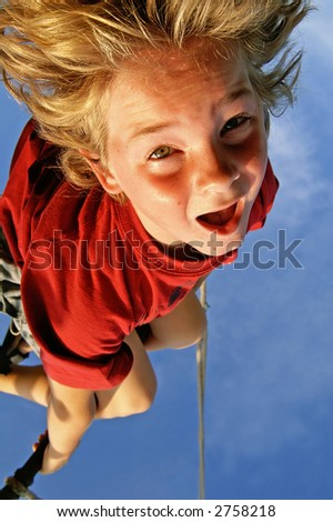 My son ones again, hanging up-side down. - stock photo