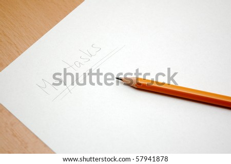 My tasks - planning paper with pencil on table background