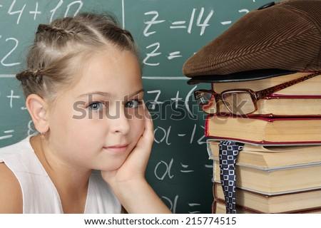 My teachers it is my books, unusual school concept, schoolgirl with textbooks as a teacher - stock photo