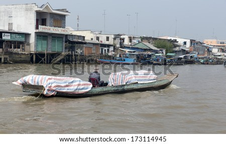 MY THO, VIETNAM - DECEMBER 29: Houses on the bank of Mekong river on December 29, 2013 in My Tho, Vietnam. - stock photo