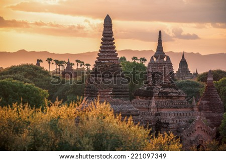 Myanmar, Bagan. Stupas of Buddhist temples at sunset - stock photo
