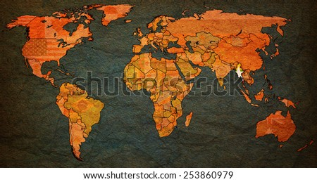 myanmar flag on old vintage world map with national borders - stock photo