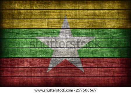 Myanmar flag pattern on wooden board texture ,retro vintage style - stock photo