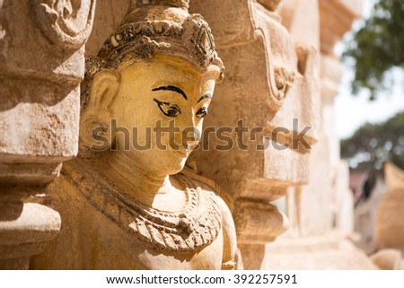 Myanmar religious statue at Ananda temple in Old Bagan, Myanmar - stock photo