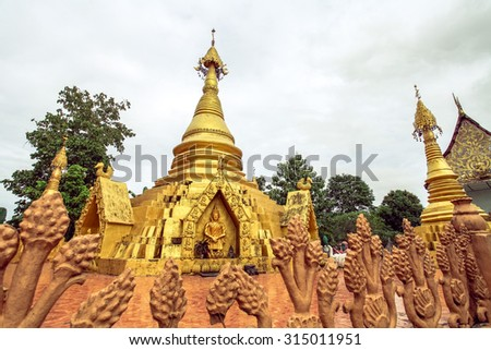 Myanmar's traditional art in the golden pagodas in a local temple in Sangkhlaburi - stock photo