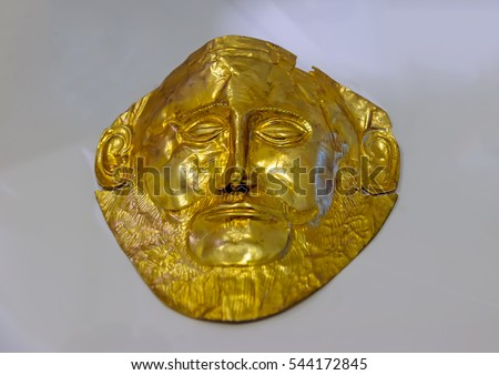 MYKINES, GREECE - OCT 27, 2013:  The famous golden face cover of the king Agamemnon in the archaelogical museum of Ancient Mykines.