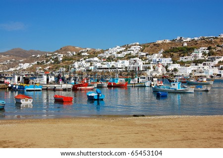 Mykonos - Colorful Boats and Hillside Homes - stock photo