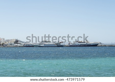 Mykonos, Greece - August 14 2016: The ships that cruise from Mykonos to Delos. Weather permitting, these ships conduct daily trips to the close island of Delos which is a UNESCO World Heritage Site.