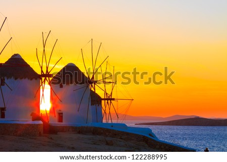 Mykonos Greece Sunset at Windmills in Mykonos Island, Greece Cyclades - stock photo