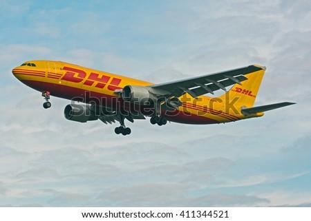 MYRTLE AVE, LONDON, GREAT BRITAN - FEBRUARY 25. DHL (European Air Transport) Airbus A300 (reg D-AEOE) landing at London Heathrow Airport (LHR). February 25, 2014 - stock photo