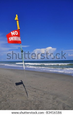 MYRTLE BEACH - AUGUST 24: Calm before the storm as Hurricane Irene takes aim at the  eastern seaboard, no swimming posted due to dangerous rip currents. August 24, 2011, Myrtle Beach, South Carolina. - stock photo