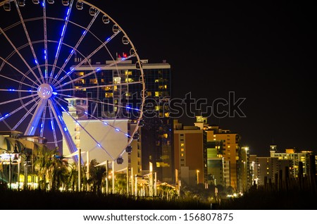 Myrtle Beach Seashore with the skywheel in the distance. - stock photo