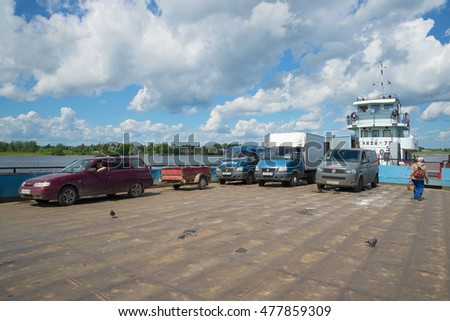 MYSHKIN, RUSSIA - JULY 13, 2016: the Cars on the deck of the river ferry. Crossing the river Volga in the town of Myshkin