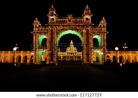 Mysore Palace  Karnataka illumination at night full of light.Temple in the Madurai, South India — the house of former royal family/Indian  Maharajas. castle lit with LED lamps. - stock photo
