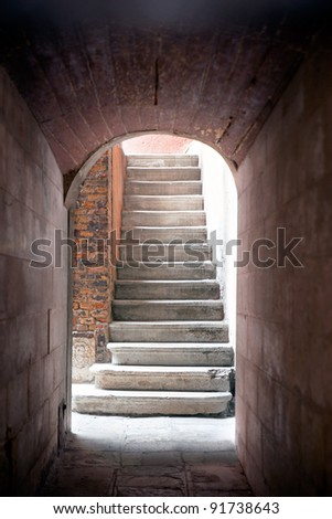Mysterious ancient empty staircase with light representing hope