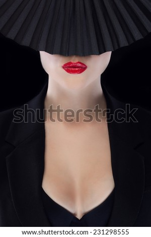 Mysterious beautiful face with red lips - stock photo