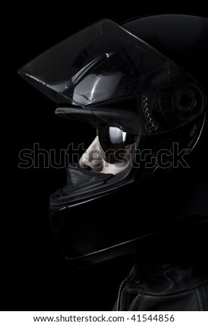 Mysterious biker in a dark environment. - stock photo
