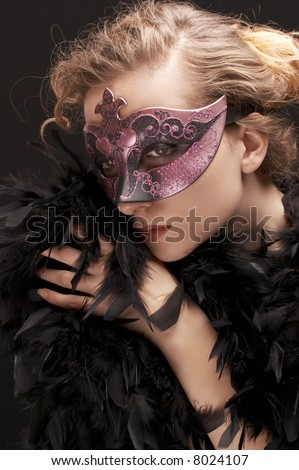 mysterious blond  woman wearing purple  stylish carnival mask and black feathers, role play - stock photo