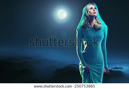 Mysterious blonde beauty in the moonglight - stock photo