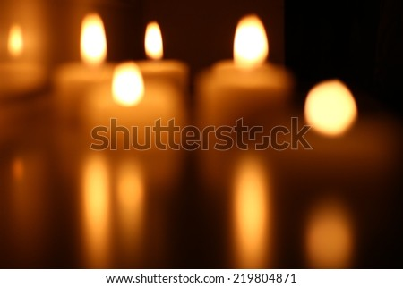 Mysterious bokeh candle - stock photo
